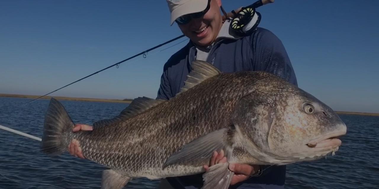 Ian Hung and a large fish.
