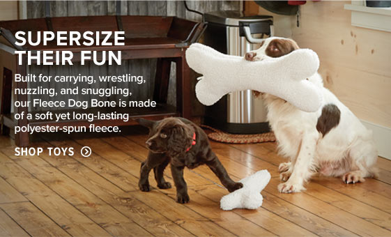 SUPER-SIZE THEIR FUN  Built for carrying, wrestling, nuzzling, and snuggling, our Fleece Dog Bone is made of a soft yet long-lasting polyester-spun fleece.  Shop Toys