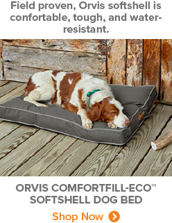 Field proven, Orvis softshell is confortable, tough, and water-resistant. | ORVIS COMFORTFILL-ECO™ SOFTSHELL DOG BED Shop Now