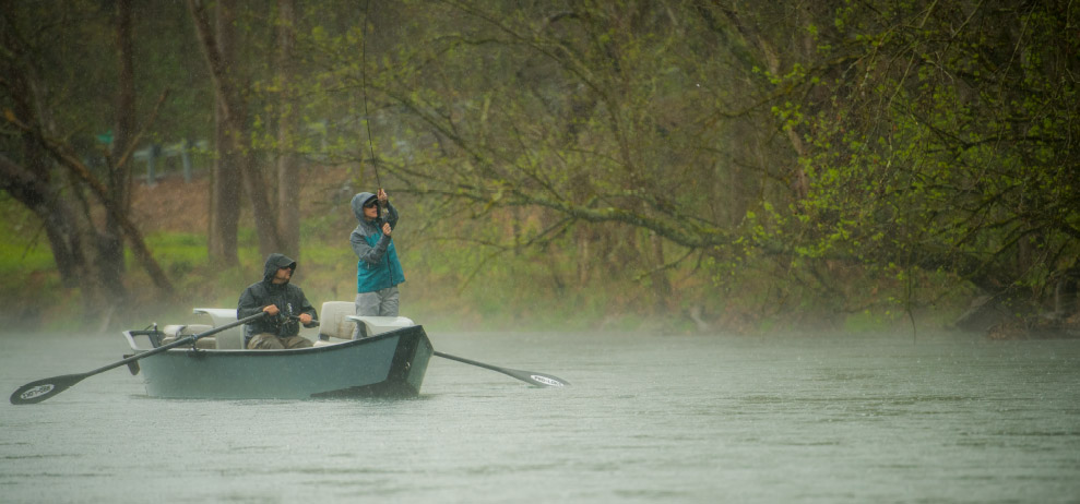 Pro Jacket being used for fishing in a rain storm.