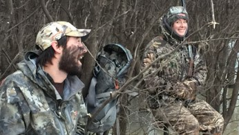 Charlie and Hannnah Perkins hunting in a duck blind.