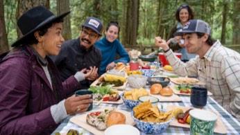 Faith having a meal with her chosen family.