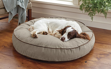 Your companion can curl up nose to tail in our beloved ComfortFill-Eco™ Round Dog's Nest bed.