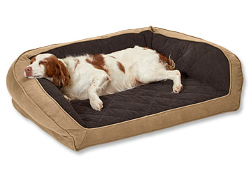 Let him curl up in supportive comfort on the Orvis Heritage Memory Foam Bolster Dog Bed.