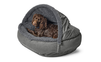 Your smaller dog will enjoy the security of the fleece-covered Orvis Burrower Memory Foam Bed.