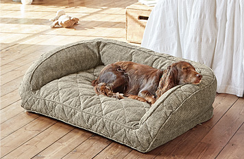 The plush bolster on our ComfortFill dog bed indulges your pet in secure comfort.