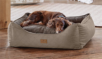 The Orvis ComfortFill 2-in-1 Dog Bed provides a comfortable space for dogs of any age.