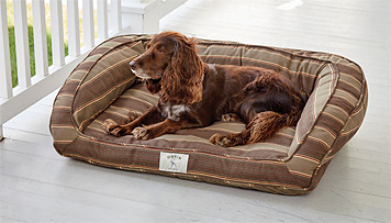 The Orvis ComfortFill Bolster Dog Bed gets refreshed with weather-resistant Sunbrella fabric.