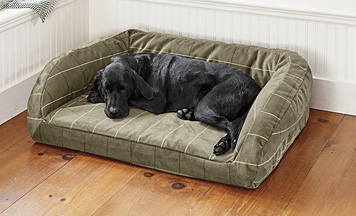 We've paired ToughChew fabric and supportive memory foam in a cozy bolster dog bed silhouette.
