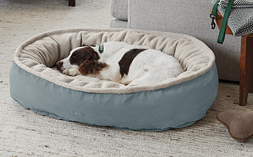 An irresistibly soft fleece sleep surface tops this durable ComfortFill Wraparound Dog Bed.