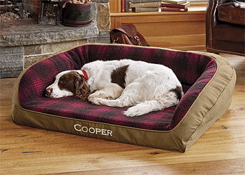 The dependable comfort of your favorite coat is mirrored in this red plaid bolster dog bed.