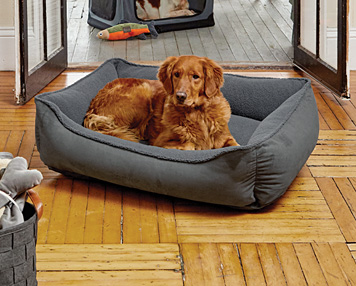 The Orvis ComfortFill-Eco™ Cuddler Dog Bed cradles your best friend in the softness of fleece.
