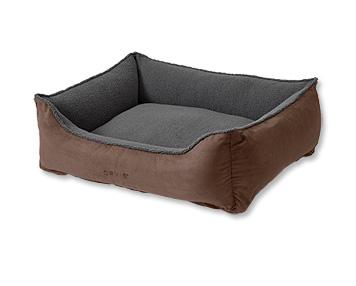 The Orvis ComfortFill-Eco™ Cuddler Dog Bed cradles your best friend in the softness of fleece.