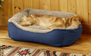 Our Denim and Shearling Cuddler Dog Bed is a durable, secure space for your furry companion.