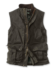Moisture beads off our Sandanona Wax Cloth Vest, making it an ideal layer against wet weather.