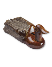 Each of these duck sculptures is carved by hand of reclaimed Rocky Mountain cedar fence posts.