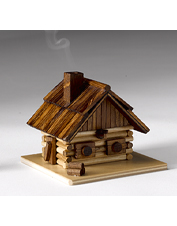 Wispy tendrils drift from the chimney of this clever wooden log cabin incense smoker.