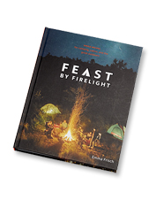 Feast By Firelight is a beautifully photographed cookbook of open-fire recipes by Emma Frisch.