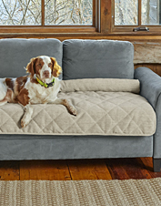 Our easy-clean Grip-Tight furniture protector is quilted and bolstered for your dog's comfort.