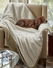 Our quilted Berber Fleece Reversible Throw makes your dog's favorite chair even cozier.