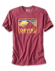 This casual T-shirt features a retro mountainscape graphic—a throwback sporting style.