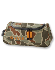 Our roomy Orvis Camo Travel Kit is rugged enough to withstand even the roughest treatment.