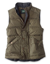 Sturdy waxed cotton and lightweight down make this puffer vest ideal for layering.
