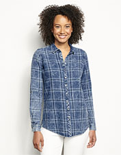 Our button-front Washed Indigo Plaid Tunic offers smart styling and three-season versatility.