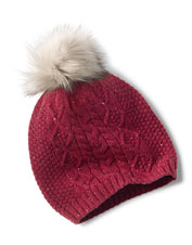 For fun and winter warmth, reach for the Donegal wool cable hat—with a faux-fur pompom.