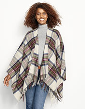Handwoven for quality, this Lambswool Plaid Wrap makes a warm and wonderful finishing touch.