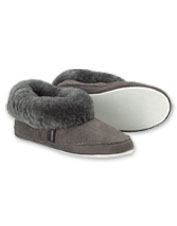 Shepherd of Sweden Emmy Slippers wrap your feet in plush, warm sheepskin.