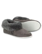 Shepherd of Sweden Emmy Slippers wrap your feet in plush, warm sheepskin.