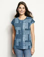 Our soft Patchwork Print Dolman Tee offers three-season comfort and styling versatility.