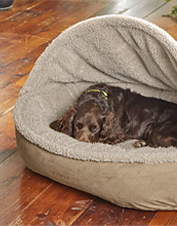 This Orvis ComfortFill-Eco Dog Bed boasts a plush fleece cover and a den-like burrow design.