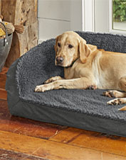 Choose this Orvis Memory Foam Bolster Dog Bed for the canine who craves fleecy comfort.