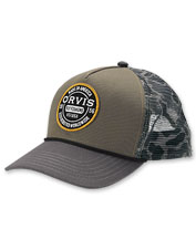 Cast in comfort wearing the breathable Orvis Worldwide Camo Mesh Trucker cap.