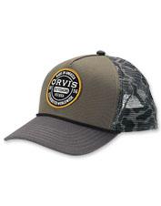Cast in comfort wearing the breathable Orvis Worldwide Camo Mesh Trucker cap.