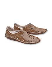 This women's slip-on moccasin pairs feminine detailing with classic styling.