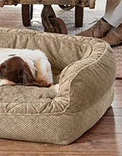 Your loyal companion deserves the thermoregulating comfort of an Orvis AirFoam Couch Dog Bed.