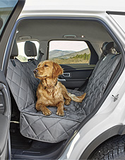 Our Grip-Tight Quilted Hose-Off Hammock Seat Protector makes traveling with dogs less messy.