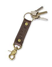 Elegant and functional, our smart embossed leather key fob handily accommodates all your keys.