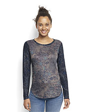 Perfect for cool weather, this soft knit tee for women showcases a dramatic brocade print.
