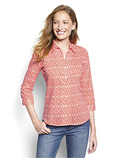 This striking button-front shirt for women showcases a dramatic pattern.