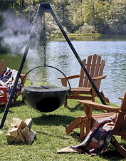Use the Cowboy Cauldron steel fire pit as an outdoor heat source, a grill, or a cook pot.