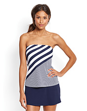 Cheerful navy and white stripes make this bandeau tankini top an always classic swim top.