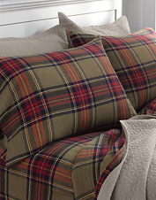 Plaid bedding gets a handsome update in our olive tartan flannel sheets, duvet, and sham.