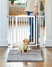 Designate a dog-friendly space with the convenience of our walk-through One-Touch Pet Gate.
