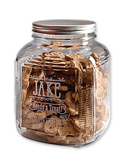 The sentiment etched upon this appealing glass dog treat jar reminds you of your canine duties.