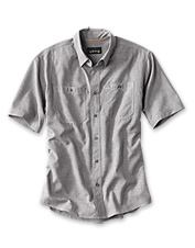 This well-appointed men's tech chambray work shirt boasts a multitude of smart features.