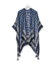 Whether knotted or wrapped, this Kimono Tassel Scarf adds graceful elegance to every outfit.